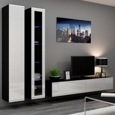 Seattle 22 - Modern TV wall unit with high gloss black MDF fronts Floating Entertainment Center, Entertainment Wall Units, Tv Wanddekor, Modern Tv Wall Units, Modern Wall, Modern Tv Cabinet, Living Room Wall Units, Tv Wall Decor, Tv Unit Design