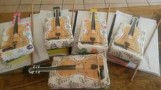 Box violins made from cookie boxes and rulers. I got the violin pictures from the fiddleheads website. The cookies may be eaten when the little ones receive their real violins.