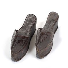 """Escapines"" or Chapins: ca. 1187, Spanish, cordovan decorated with embossing with a sole of leather and cork platform. ""Cistercian Monastery of Santa Maria la Real de Gradefes, Leon. these boots, well known in the monastery from which respond to the type of footwear called Chapin, who is characterized by high cork soles and have no heel. They belonged to Dona Teresa Petri, noblewoman and founder of the house of Santa Maria Bernarda Royal Gradefes..."""