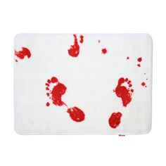 Blood Bath Mat, $15, Amazon  For Halloween or just because you're a little bit morbid, this blood bath mat turns red where it gets wet.