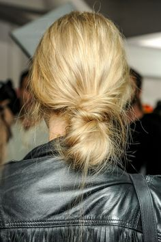 Marni. Messy, deep diagonal parts given a worn-in texture and tied into a ponytail-knot hybrid.