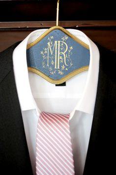 """Black + pink groom outfit idea - black jacket + white button-down shirt with pink + white stripe tie displayed on custom """"Mr"""" hanger {Pepper Nix Photography}"""