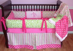 Paige Baby Bedding  Included in this set is the bumper, blanket, and crib skirt.  There is lots of detail in this custom set including soft minky in pink, hot pink grosgrain ties, hot pink polka dots, multi shade pink and green stripe, green cartwheel swirls, and pink and green damask.