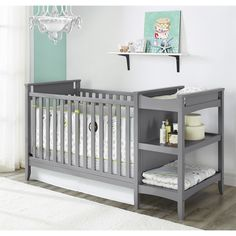The simple, clean lines of this unique crib are beautifully offset by the light wood finish. The raised crib side panels add visual interest, and the beautiful grey finish allows you to coordinate with multiple bedding and decor options. #babynurserydecor