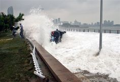 Typhoon watchers' cars engulfed by giant waves in China (Photo: AFP - Getty Images) Giant Waves, Nbc News, Extreme Weather, Natural Disasters, Mother Nature, Fighter Jets, Photo Galleries, World, Gallery
