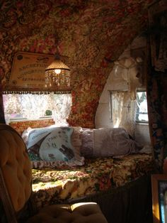 I like the ouija board hanging over the window.  I like the dusty earthy colors as well.