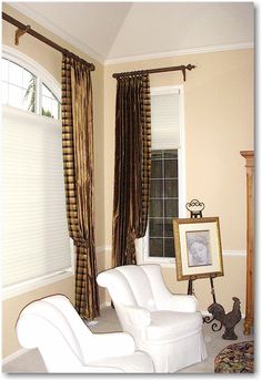 Solid and plaid silk draperies on wood poles and tiebacks with Hunter Douglas Silhouette Shades.