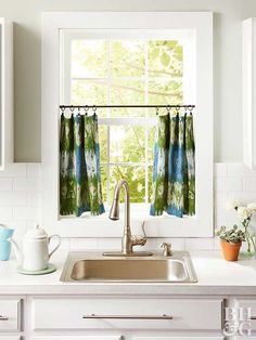 Make these cafe curtains in a couple of minutes. Press desired tea towels, scarves, or hemmed fabric with an iron, then attach to a rod with ring curtain clips. A tension rod works best for this project as you'll need to adjust the rod's height depending on the towels' length, and width to fit the window frame.