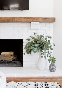 Modern Rustic Painted Brick Fireplaces Inspirations - Decorating Ideas - Home Decor Ideas and Tips Decor scheme - white, brick (natural or white but not gray), and wood Painted Brick Fireplaces, Wood Fireplace, Fireplace Design, Fireplace Modern, White Painted Fireplace, Reclaimed Wood Mantle, Fireplace Ideas, Wooden Mantle, Decorative Fireplace