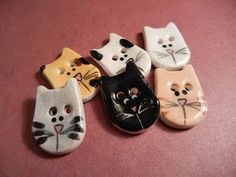 So...I couldn't resist posting a pic of some of the ceramic buttons I make. I feel almost famous. LOL.  =] #buttons, #cats