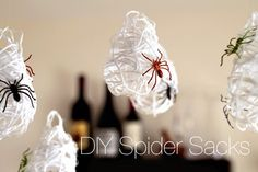 Create your own spooky spider sacks using Elmer's glue, yarn, water, and a balloon. Then just glue on some plastic spiders, hang them up in your home, and you're ready for a #Halloween scare! #DIY #spiders #kidscraft