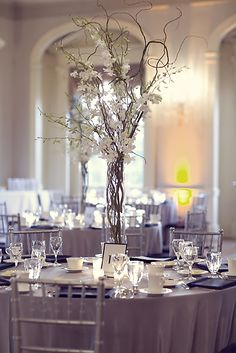 Tall centerpieces are great- we could do yours with orange and white flowers- add some crystals if you want some bling. Use candles around the base to give it a romantic glow...