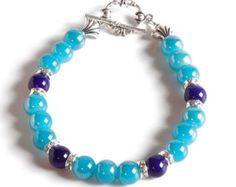 Check out AQUA & PURPLE Women's stackable bracelet, stacking bracelet, statement bracelet, beaded bracelet on dunglebees