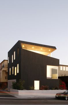 Image 12 of 16 from gallery of AIA California Council's 2012 Design Award Recipients. Surfhouse, Hermosa Beach / XTEN Architecture - Image courtesy of Art Gray. Houses Architecture, Installation Architecture, Architecture Images, Beautiful Architecture, Residential Architecture, Contemporary Architecture, Interior Architecture, Black Architecture, Mos Architects