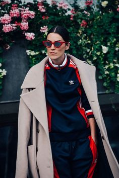 Track suit and trench coat look, pop of red outfit, red frames sunglasses, track suit outfit, street style fashion, edgy street look,