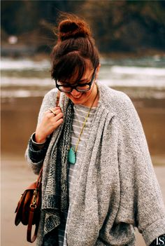 Oversized sweater, turquoise necklace.