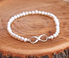 infinity knot stretchy bracelet with 3mm high nacre freshwater pearl. natural white (ivory). 17cm or 18cm