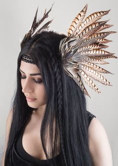 This Headdress was designed with love by Drafted Eminence, this piece is called, Ether. Ether is made of all natural Pheasant feathers that are carefully layered upon one another to add extra dimension and enhance the natural patterning in the feathers.  These feathers are black, grey and cream colored with intricate and elaborate patterns running throughout them. Each feather ends naturally in a pointed tip adding extra drama to the piece.  This headpiece is very light and easy to wear. It…
