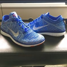 Nike Free TR Flyknit 5.0 NIB Womens' Nike Free TR Flyknit!   Only tried on in store.   Purchased 2 colors bc I couldn't decide so keeping the other.   Colors r blue and white w a bit of a reddish orange.   Super comfy shoes for those who don't own a pair.   I'm typically a shoe sz 7/7.5 and the 7.5 is a good fit.   Great shoes for working out or traveling  *NO TRADES* Nike Shoes Sneakers