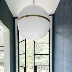 We truly love the minimal take on midcentury modern style that is the Truax chandelier designed by Brian Patrick Flynn for Crystorama Lighting! It's a pretty big chandelier, so it's great for lighting up larger spaces.   #midcenturymodernlighting #chandelierlighting #largechandelier #chandelierfoyer #chandelierentryway
