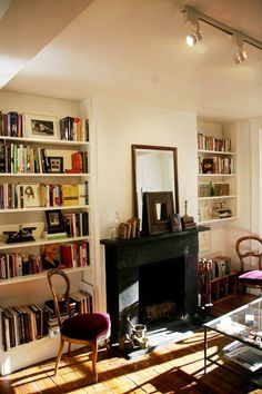 so cozy! love the chairs & all the books