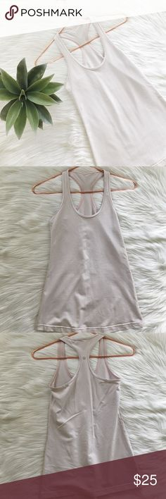 Lululemon Gingham Tan Cool Racerback Tank Lululemon gingham cool racerback tank size approx 6, or small. Tan and white. No stains or holes, smoke and pet free home! Offers welcomed! lululemon athletica Tops Tank Tops