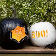 """Anchored by tiny nails, a white web highlights the carved opening in a black pumpkin. For fun, pair it with a contrasting white orb shouting """"BOO!""""Carve the Spiderweb Pumpkin: Hollow out one large pumpkin; spray-paint black. Transfer the free pattern to the pumpkins and use a knife or carving tools to cut out. Tap in pin nails along the outside edges of the spiderweb opening. Wrap white string around the nails to create the look of a spiderweb with straight anchor threads and a spiral thread…"""