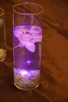 table decor...used white gravel for bottom of vases