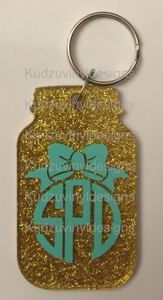 "3"" Acrylic Mason Jar shape keychain.  Gold Glitter on the back and your monogram on the front.  This is available in a variety of vinyl colors.  Order yours today!  $9.00 each plus shipping if needed. check out our page: www.kudzuvinyldesigns.com"