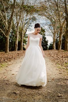 The romantic Michaela gown created with a lace boat neckline and cap sleeves from Bertossi Brides at Paddington Weddings
