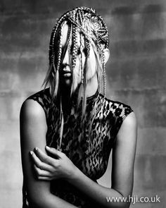 404c540b89f1 2012 multiple plaits hairstyle Long blonde hair was tightly plaited and  cornrowed across the head in