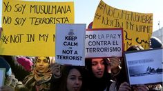 "Muslim women in Madrid, Spain:  "" Keep Calm I am Not A Terrorist""   - BBC #JeSuisCharlie"