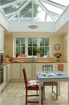 Kitchen Conservatory - I like the window at the end and the lantern roof. Kitchen not so much my style.