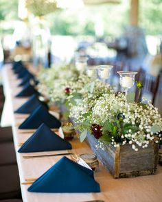 Classic wedding reception table idea - wooden flower box centerpiece and blue napkins {Cadey Reisner Weddings}