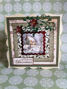 Festive Christmas papers, Cheery Lynn Holly flourish, XCut flower punch, Go Kreate frilly frame #7 base card.