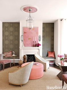 "To create a modern living room for a Capitol Hill row house, designer Barry Dixon choose a pink and brown palette. ""It's both masculine and feminine. They set each other off,"" he says. The dark browns keep the pinks from appearing too frothy. The French Club Chairs are by Niermann Weeks and a Tuscany ottoman is by Stewart Furniture. Bell lantern by Chameleon."