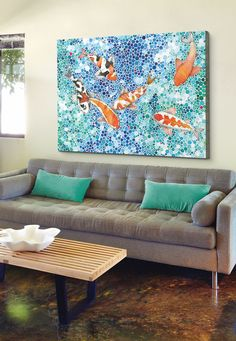Contemporary blue and aqua painting of six koi fish in a stylized pond by Ana Victoria Calderon with a sleek modern tufted couch via @greatbigcanvas available at GreatBIGCanvas.com.