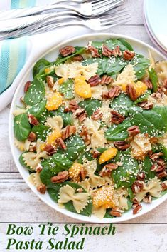 Bow Tie Spinach and Pasta Salad is made with Farfalle pasta fresh baby spinach mandarin oranges and toasted pecans tossed with an Asian ginger dressing. Pasta Salad With Spinach, Pasta Salad Recipes, New Recipes, Healthy Recipes, Healthy Food, Unique Recipes, Amazing Recipes, Dinner Recipes, Asian Ginger Dressing