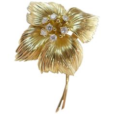 """Van Cleef and Arpels Diamond Yellow Gold Brooch. A yellow gold """"Wild rose"""" Van Cleef and Arpels broach set with seven diamonds in the center.  Height : 55 mm  Weight 20,1 grams. Circa 1959"""