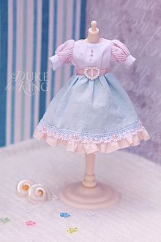 "https://flic.kr/p/aoSf69 | 400th Licca pic dress | A special Licca dress I've made to celebrate the 400th Licca picture in my Flickr, as seen  here.  Even though I'm still new at sewing dolly clothes, I try to give the dresses little details that hopefully make-up for the sewing mistakes and unevenness at least a little. Sometimes details can ""elevate"" an otherwise crooked/lacking/etc piece.  I'm a big fan of pastel colors and the palette of pale blue, powder and white appealed to ..."
