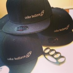 cake ballers cake baller caps! Hey, you!! Great news! We have got ya covered. Need a cake baller snap-back for your cap collection? Holler at a baller and score one of these bad boys. And the sweetest part of the whole deal: a dozen of our cake balls. Info@cakeballers.com or www.cakeballers.com #thecakeballers #cakeballers #cakeballer #snapback #flatbrim #cakeballersloveboise #eatmorecakeballs #wearlocalswag #swag #brassknuckles #cake #black #baller #boiseidaho #hollerataballer #idahome