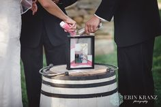 Sand pouring during your wedding ceremony into a glass frame! Erin Kranz Photography » Charlotte NC Wedding Photographer