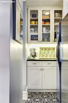 Upper West Side Kitchen with under-cabinet LED lighting and ornate cement encaustic tiles from Mosaic House.