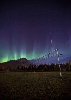 Touchdown - Aurora over Banff town, Alberta, by Paul Zizka... #Canada #Park #Night #Mountain #Lights #Field #Alberta #Cascade #Banff #Aurora #Canadian #Darkness #Football #Soccer #Rocky #Goal #Astrophotography #Nighttime #National #Northern #Rockies #Net #Borealis