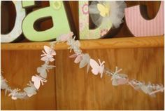 adorable mini banner made with ponybeads and paper punch