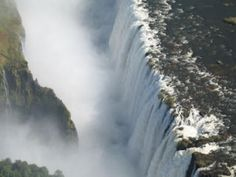 The Victoria Falls ictoria Falls presents a spectacular sight of awe-inspiring beauty and grandeur on the Zambezi River, forming the border between Zambia Victoria Falls, Travel Memories, What A Wonderful World, Africa Travel, Heaven On Earth, Wonders Of The World, Places Ive Been, Manchester, Waterfall