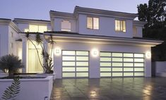 Take your home and garage to the next level with full view modern glass garage doors. We're sharing 7 great benefits of a modern glass garage door here. Garage Door Sizes, Garage Door Panels, Garage Door Hardware, Overhead Garage Door, Glass Garage Door, Garage Door Repair, Glass Door, Contemporary Garage Doors, Modern Garage Doors