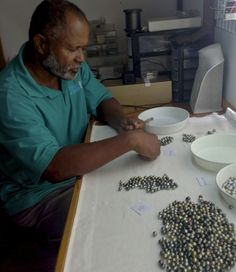 Fijian pearl farmer Ratu Jone in our grading room learning how to grade his pearl harvest with our pearl graders.