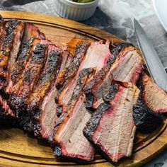 Smoked Brisket - Spicy barbecue so worth the wait. Brush up on your barbecue skills with this smoked brisket tutorial. Smoker Recipes, Grilling Recipes, Meat Recipes, Cooking Recipes, Rub Recipes, Traeger Recipes, Cooking Tips, Smoked Brisket Recipes, Jerky Recipes
