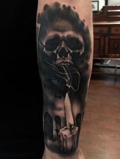 Skull and candle tattoo by Lou Bragg